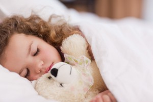 sleeping child with animal