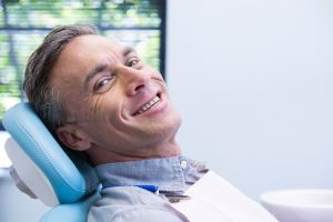 man happy at dental exam